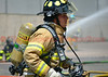 A Peterson Air Force Base Firefighter on the scene of a working fire with Cimarron Hills Firefighters. August 7, 2014