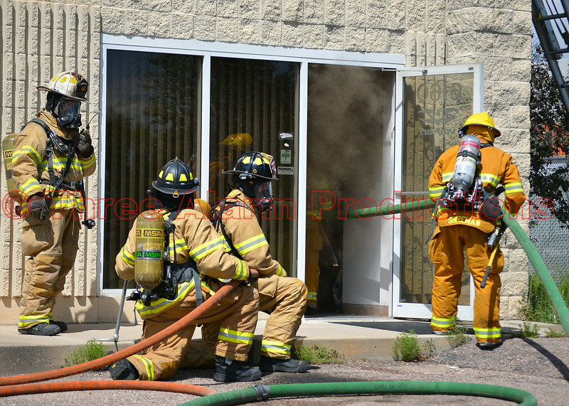 Multiple fire attack crews battling a 4-alarm blaze in a commercial building on Lake Shore Court in El Paso County, Colorado, USA. August 7, 2014