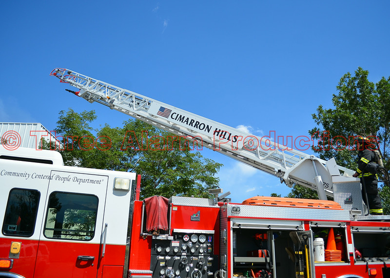 Driver/engineer placing aerial ladder in position on a 4-alarm commercial building fire.