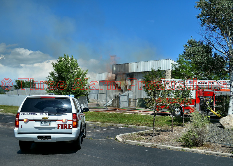 Cimarron Hills Firefighters arrive on scene of a commercial structure fire call, with heavy flames showing and ongoing explosions on Lake Shore Court.  August 7, 2014