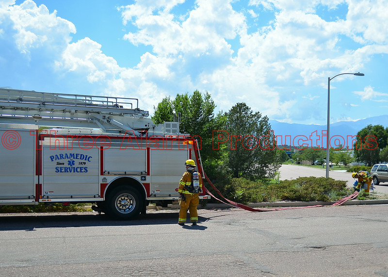 Colorado Springs Firefighters with Engine 17 bringing in a water supply, with dual LDH lines from a hydrant at the corner of Lake Shore Court and Waynoka Road,  on mutual aid response for Cimarron Hills Fire Department on a working commercial structure fire. August 7, 2014