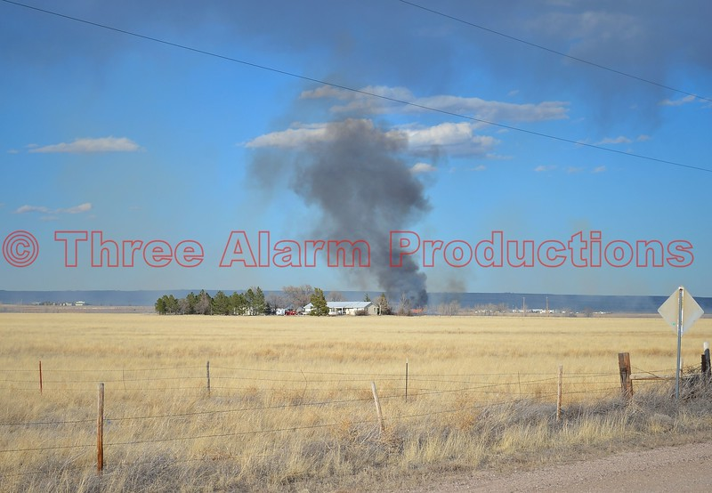 Horse barn on fire, with wildland fire in Ellicott, Colorado, which is located east of Colorado Springs. Multiple fire agencies on scene, from eastern El Paso County Fire Departments, working the incident. March 28, 2015