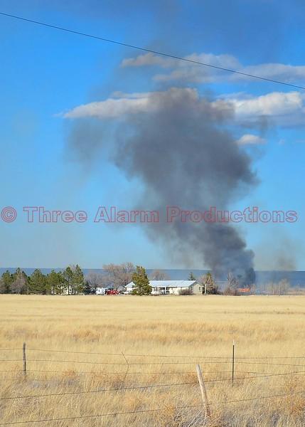 Ellicott Firefighters battle a wildland interface fire in eastern El Paso County, Colorado. March 28, 2015