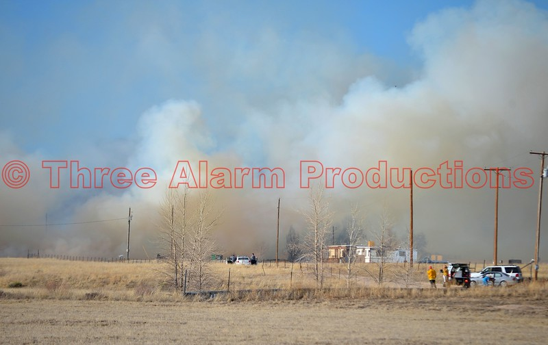 Heavy smoke moves across the area, as firefighters from multiple fire agencies in El Paso County, Colorado, work to control a wildland interface fire. March 28, 2015