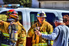 Fire Personnel talking with fire command.