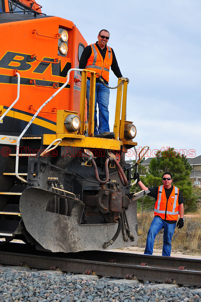 BNSF Locomotive No. 5951, with crew standing by and monitoring conditions on the railway that was temporarily shut down, due to a wildland fire along the tracks in Monument,  Colorado.