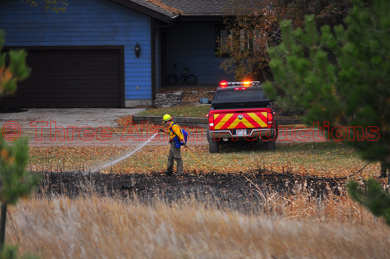 Firefighters brought the wildland fire under control before it could damage the nearby home, during this incident.