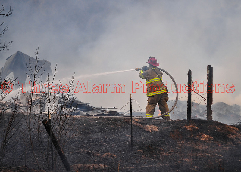 Multiple fire agencies come together to fight a barn fire and wildland fire in Monument, Colorado, near Baptist Road and Interstate 25