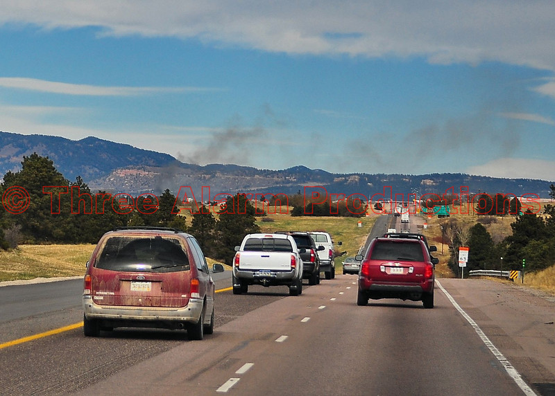 The smoke plume from the Monument fire could be seen miles away. This is a shot through my windshield looking northbound on Interstate 25 toward Monument, Colorado.
