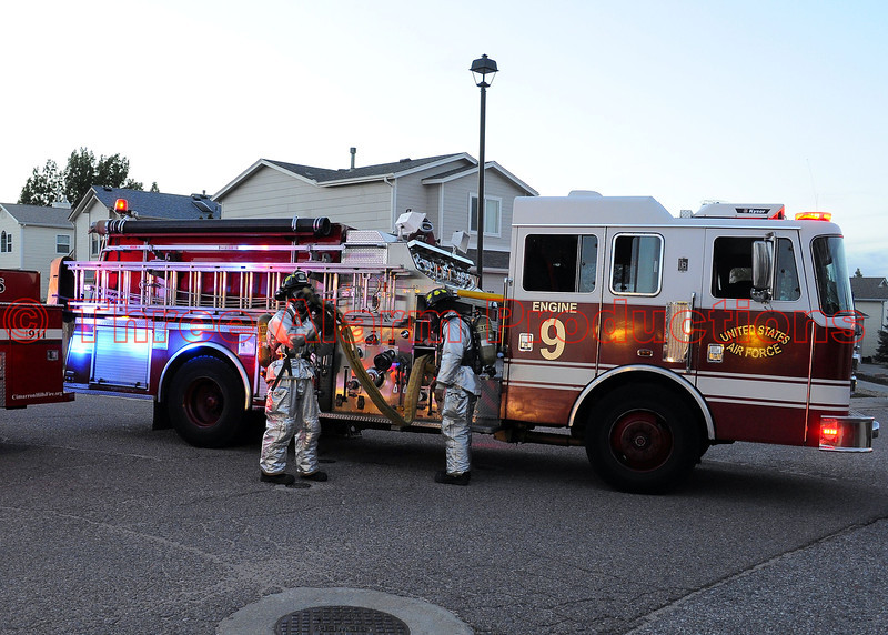A crew with Peterson Air Force Base-Engine 9, bringing in a secondary fire attack line, providing mutual aid to Cimarron Hills Fire Crews.
