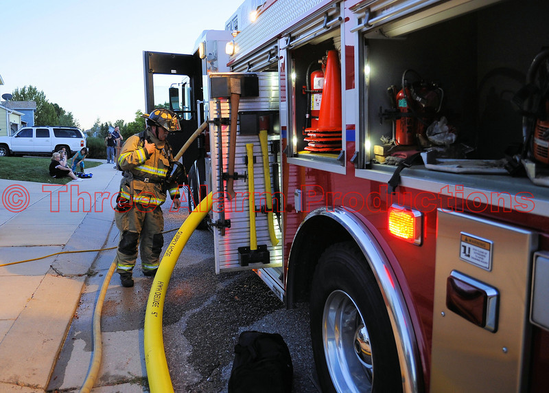 Ladder Truck 1331 on the scene of a basement fire in a house, in Cimarron Hills, Colorado.