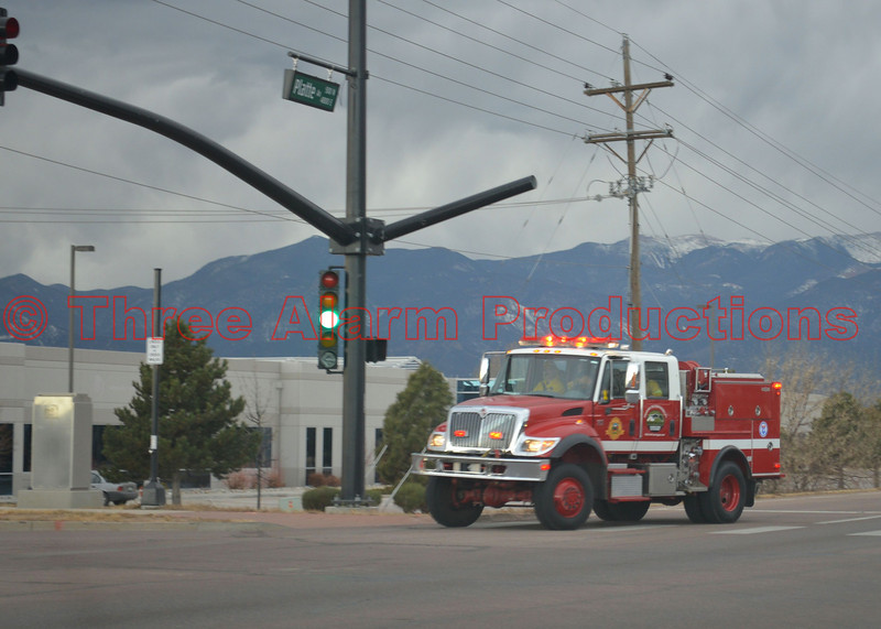 "Colorado Springs Fire Department's Wildland Engine 4, responding code 3 to a wildland fire burning in the field behind ""The Flea Market"" on E. Platte Avenue. December 28, 2013"