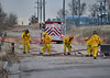 """Colorado Springs Firefighters creating a hose ramp over a water supply line, for protection during a wildland fire behind """"The Colorado Springs Flea Market."""" December 28, 2013"""
