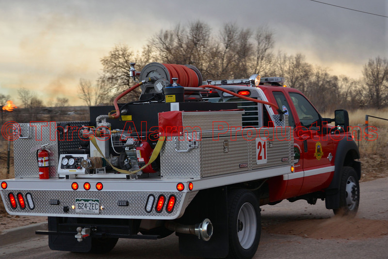 Colorado Springs Brush Truck 21, responding to a large debris pile fire in the field behind the Flea Market on Platte. December 28, 2013