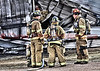 Falcon Fire Fighters on the scene of a feed storage building fire.