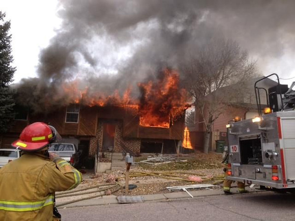(This Photo Courtesy of Colorado Springs Fire Department's PIO)<br /> 2-alarm house fire on Chaparral Drive on November 8, 2013, with heavy fire showing on arrival.<br /> CSFD Firefighters work to bring a house fire under control, that had exploded, due to a natural gas line that was not secured properly within the home.