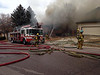 (This Photo Courtesy of Colorado Springs Fire Department's PIO)<br /> 2-alarm house fire on Chaparral Drive on November 8, 2013<br /> CSFD Firefighters work to bring a house fire under control, that had exploded, due to a natural gas line that was not secured properly within the home.