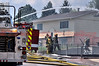 Multi-agency fire crews working to bring a fully involved house fire on Viking Drive in Colorado Springs, Colorado, USA