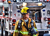 A Colorado Springs Fire Fighter on the scene of a working structure fire.