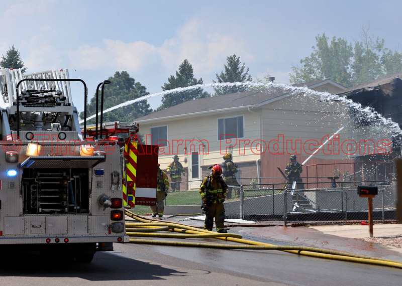 Multi-agency fire crews working to bring a fully involved house fire on Viking Drive in Colorado Springs, Colorado, USA.