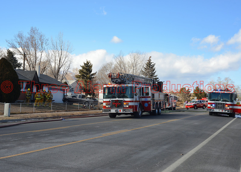 Multiple fire trucks and fire engines on the scene of house fire on Monterey Road. Four victims were transported to the hospital. December 24, 2013