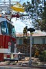 Colorado Springs Firefighters cut holes in the roof to exhaust heavy smoke in a single family home that was on fire in the 5100 Block of Palmer Park Boulevard. March 29, 2015