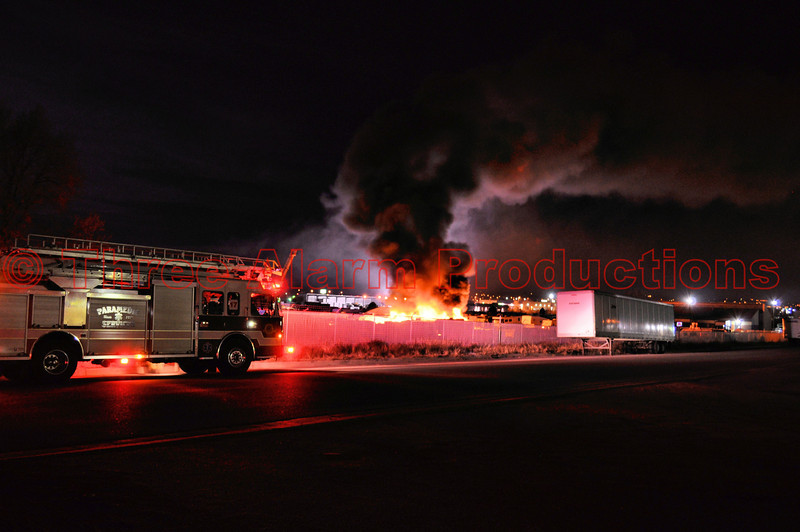 Colorado Springs Ladder 17 arriving on scene to assist Cimarron Hills Firefighters in controlling a storage lot blaze off of U.S. Highway 24, in eastern El Paso County, Colorado.