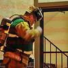 A firefighter putting on his air supply as he gets ready to enter the hotel.