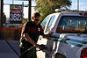 A U.S. Forest Service Employee fueling up in Florence, and headed to the Wetmore Fire.