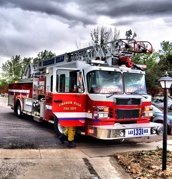 """Lieutenant Matt Rasdall arriving on CHFD Ladder Truck 1331, along with CHFD Brush Truck 1340, on a wildland fire threatening to move thru a mobile home park off of Western Drive in Cimarron Hills, Colorado. See this location on Google Maps at: <a href=""""http://goo.gl/maps/BkpR"""">http://goo.gl/maps/BkpR</a>"""