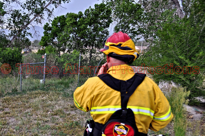 Lt. Matt Rasdall approaching the fire scene. CHFD Brush 1340 can be seen in the background on the other side of the fence.