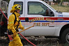 Fire Fighter Christian Hererra on the scene of a wild land fire in Cimarron Hills, Colorado USA.
