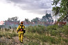 Lieutenant Matt Rasdall with Cimarron Hills Fire District, doing a size up on a wildland fire that is threatening to move into a neighborhood on a Saturday afternoon.