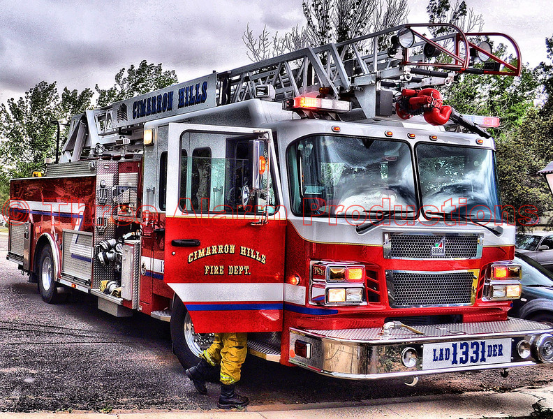 """Lieutenant Matt Rasdall arriving on CHFD Ladder Truck 1331, along with CHFD Brush Truck 1340, on a wildland fire threatening to move thru a mobile home park off of Western Drive in Cimarron Hills, Colorado.  See this area on Google Maps at: <a href=""""http://goo.gl/maps/BkpR"""">http://goo.gl/maps/BkpR</a>"""