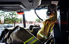 Lt. Matt Rasdall in the officer's seat of CHFD Ladder Truck 1331 en route code 3 to a report of a wildland fire that is heading towards a neighborhood in Cimarron Hills, Colorado, USA.