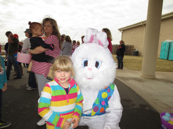 Rylea Mendenhall, 6, hangs out with the Easter Bunny at Fort Gibson Church of Christ on Saturday during the church's annual Easter celebration.
