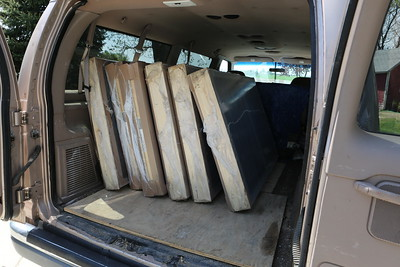A van full of Marvin Windows waiting for their new permanent home at 6438 Grandview.