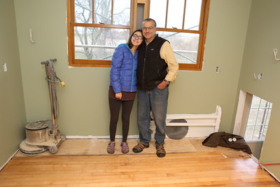 Hannah and Myron pose where kitchen cabinets will be installed the following week