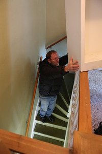 Mark reaches for the stars !  Make that the heavy shelf to support down the stairs.