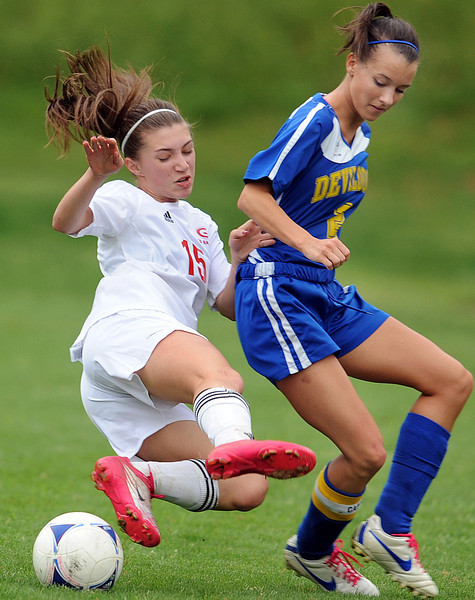 Greenville's Kaiya Trask (15) and Travelers Rest's Michelle Brown (2) battle for control of the ball.<br /> The Greenville Red Raiders played host to the Travelers Rest Devildogs in a region soccer match at Sirrine Stadium in Greenville.<br /> GWINN DAVIS / Staff<br /> Greenville News Media Group<br /> gdavis@greenvillenews.com  <br /> (864) 915-0411<br /> March 29, 2012
