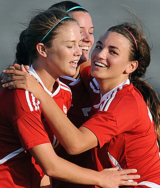 Greenville's Grace Stewart (12), Mollie Waters (6) and Amanda Barlow (7) celebrate.<br /> The Eastside Eagles played host to the Greenville Red Raiders in a region soccer match.<br /> GWINN DAVIS / Staff<br /> Greenville News Media Group<br /> gdavis@greenvillenews.com  <br /> (864) 915-0411<br /> April 10, 2012
