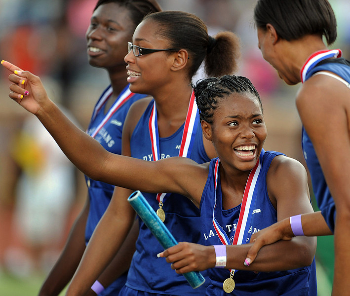 The Woodmont 400-Meter Relay Team reacts to winning the Gold Medal at the State Track Championships.<br /> Spring Valley High School in Columbia was the site for the 2011 State Track Championships.<br /> GWINN DAVIS PHOTOS<br /> (864) 915-0411<br /> gwinndavis@gmail.com<br /> May 14, 2011