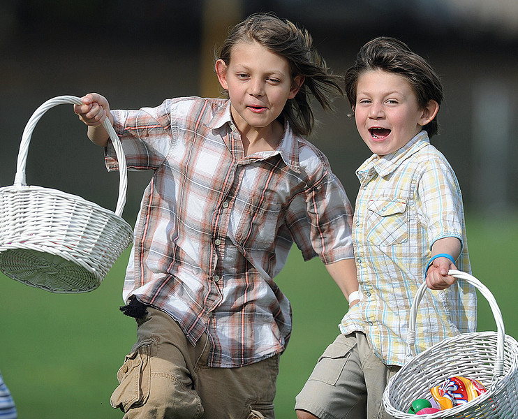 John John Comeau, 9, left, and his brother Alexander Joseph, 5, race for the eggs.<br /> The City of Mauldin along with area churches held the 2012 Helicopter Easter Egg Drop at Sunset Park.<br /> Other events:<br /> Games: bean bag toss, ring toss, bowling, color<br /> wheel, and much more<br /> Face Painting , Muppet Shows, Photo Booth with<br /> the Easter Bunny<br /> Inflatable slides and Bounce houses<br /> Inflatable<br /> GWINN DAVIS / Staff<br /> Greenville News Media Group<br /> gdavis@greenvillenews.com  <br /> (864) 915-0411<br /> March 31, 2012