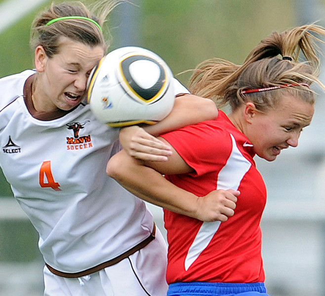 Mauldin's Lauren Young (4) and Riverside's Hannah Allison (13) battle for control of the ball.<br /> The Mauldin Mavericks played host to the Riverside Warriors in the Class AAAA Upper State Soccer Championship Match.<br /> GWINN DAVIS PHOTOS<br /> (864) 915-0411<br /> gwinndavis@gmail.com