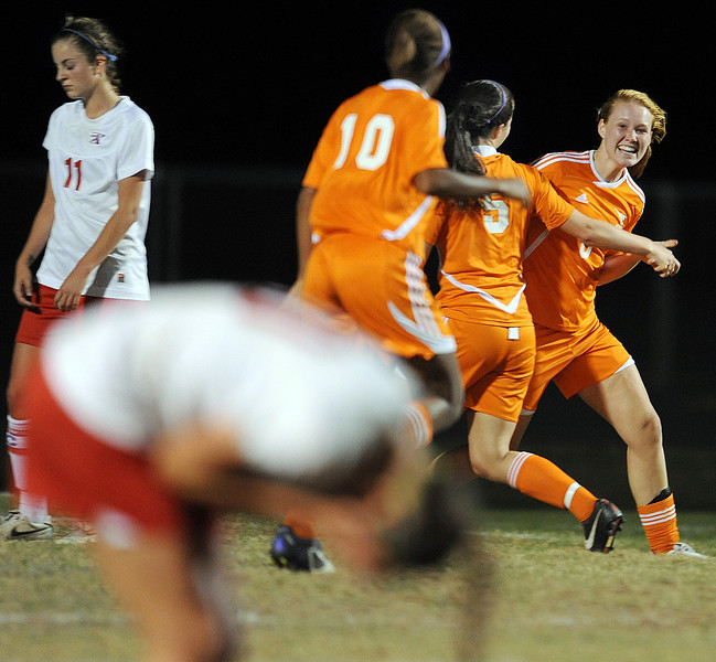 Mauldin's Tori Pilgrim (8) scores and celebrates with teammates.<br /> The Riverside Warriors played host to the Mauldin Mavericks in a Region 2-AAAA soccer match.<br /> GWINN DAVIS / Staff<br /> Greenville News Media Group<br /> gdavis@greenvillenews.com  <br /> (864) 915-0411<br /> March 26, 2012