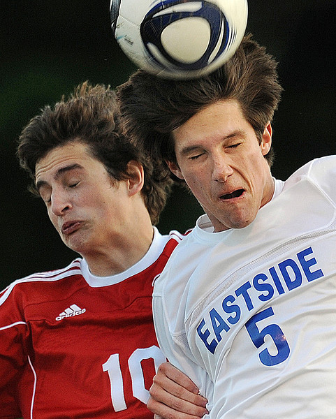 Eastside's Ben Fowler and Greenville's Reid Perkinson battle for control of the ball.<br /> The Eastside Eagles played host to the Greenville Red Raiders in a region soccer match.<br /> GWINN DAVIS / Staff<br /> Greenville News Media Group<br /> gdavis@greenvillenews.com  <br /> (864) 915-0411<br /> April 10, 2012