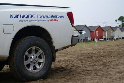 The side of a Habitat truck with contact information. The website  is a great rescource for information on how to become a volunteer.