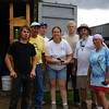 A group of volunteers gather outside of one of the many tool trailers...still looking happy after a days work.