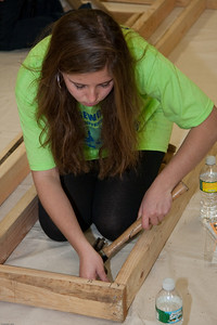 (1) Pslip Slug #: W 25054; (2) Ridgewood, NJ; (3) 10/24/09; (4) Habitat for Humanity Builds a House for Make a Difference Day on 10/24/2009; (5) Kaitlyn Cuneo concentrates on her assignment during Habitat for Humanity's project during Ridgewood's Make a Difference Day on 10/24/2009; (6) W.H. Grae for the Ridgewood News.