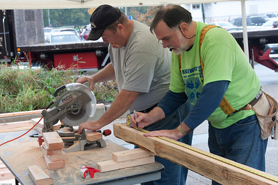 (1) Pslip Slug #: W 25054; (2) Ridgewood, NJ; (3) 10/24/09; (4) Habitat for Humanity Builds a House for Make a Difference Day on 10/24/2009; (5) (L-R) Jack Carroll and Father Stuart Smith prepare more materials for assembly during Habitat for Humanity's contribution to Ridgewood's Make a Difference Day on 10/24/2009 ; (6) W.H. Grae for the Ridgewood News.